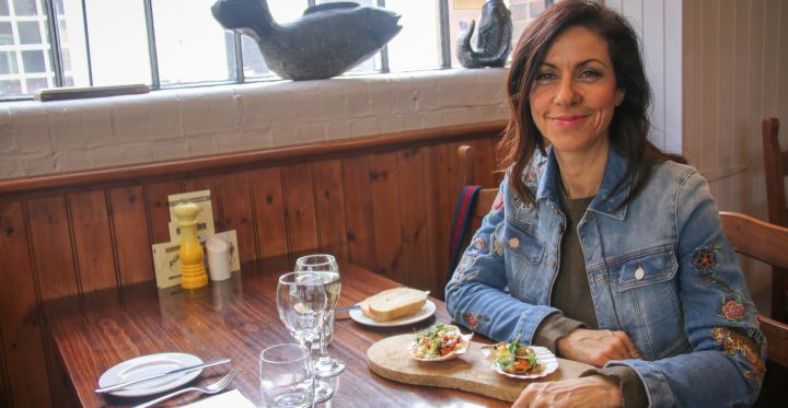 Julia Bradbury eating scallop in Webbes Cafe, Rye, East Sussex, (images owned by The Outdoor Guide licensed to VisitEngland