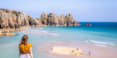 girl staring at sea in Cornwall