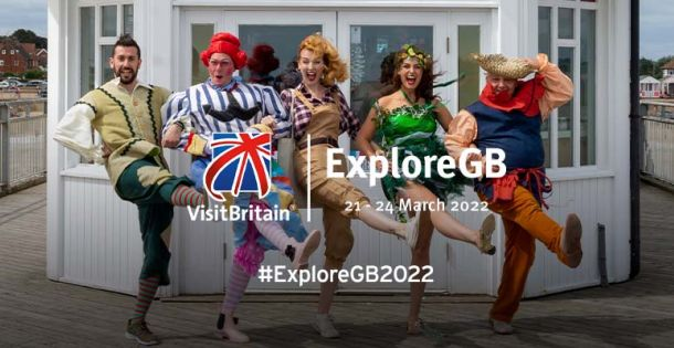 Image of fancy dressed people doing the Cancan on a pier with ExploreGB event logo