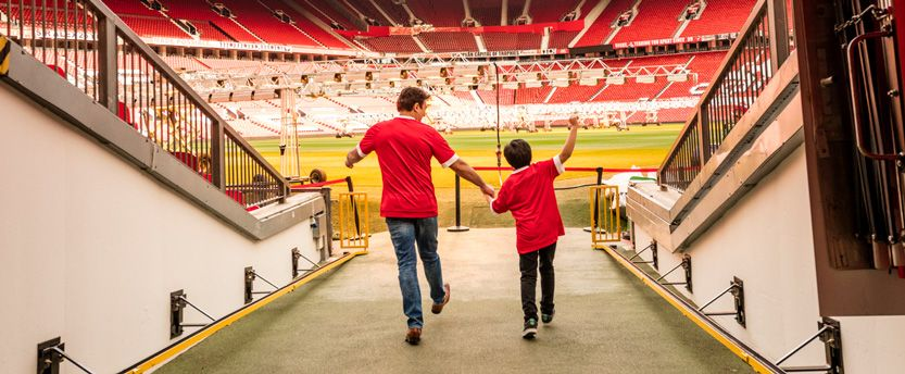 Man and boy at football stadium _ manchester united