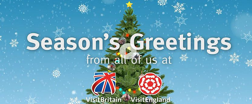 VBVE animated Christmas Card showing baubles featuring wintry scenes of UK destinations jingling merrily on a Christmas Tree, with snowflakes falling in the background.