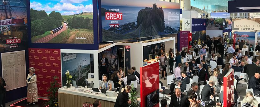Aerial view of exhibition stand at ITB with people holding meetings at tables on the stand