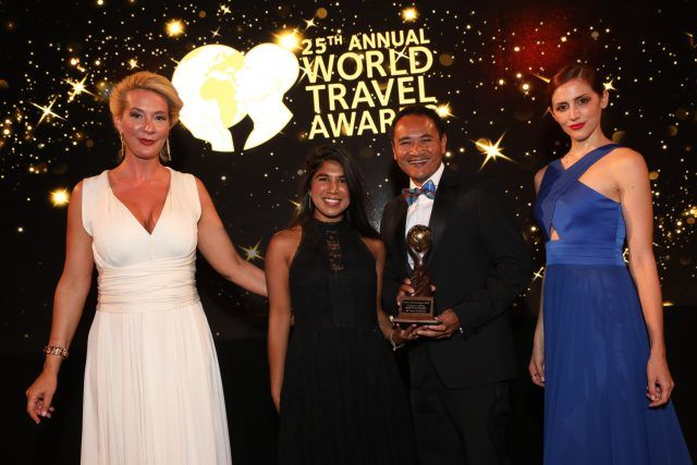 Collecting the award from the World Travel Awards