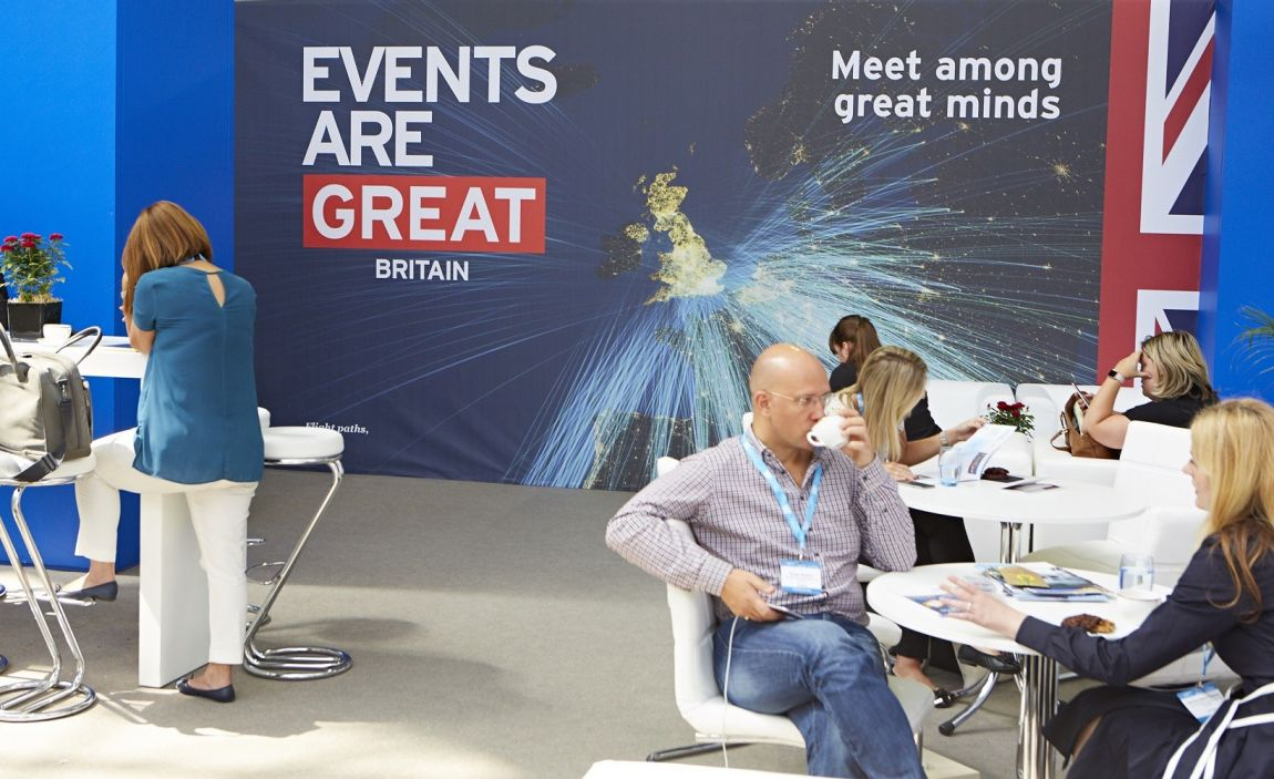 Delegates in front of an Events are GREAT branded backdrop