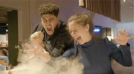 A still from Episode 1 of Mission Accessible 2: Big Zuu and Rosie Jones messing about in the Science Museum