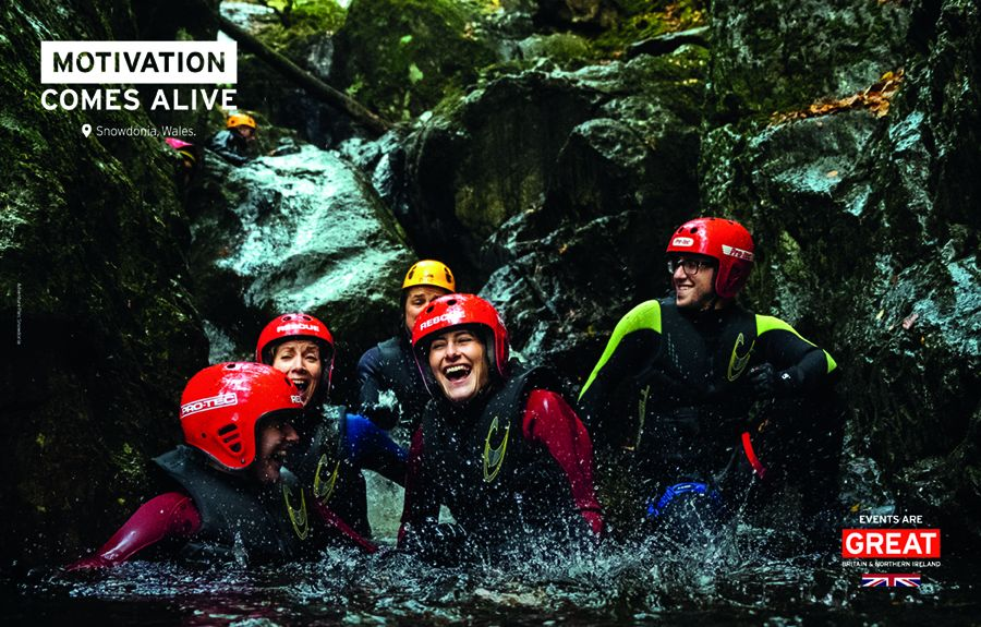 Group of people caving in Snowdonia Wales, Events Are GREAT branding 'Motivation comes Alive'