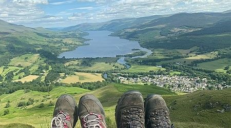 Two hikers enjoying the view, Sron a Chlachan, Highlands, Scotland.