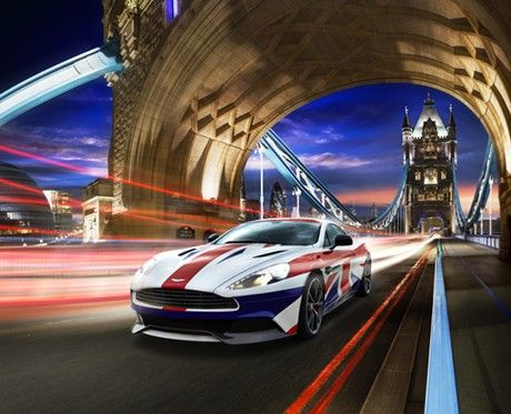 A car wrapped in the Union Jack speeds through the London bridge at night