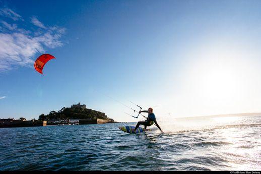 A man kite surfing near St Michael's Mount, Cornwall