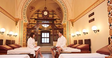 Couple wearing white bathrobes relaxing in the Turkish Baths Spa in Harrogate, North Yorkshire, England.