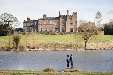 Couple enjoying a day out near medieval Ripley Castle and Garden near Harrogate, North Yorkshire, England.