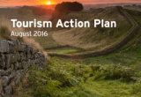 A cover shot of the Tourism Action Plan featuring a green valley and a sunset in the distance