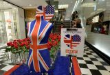 Shop floor at Bloomingdales with Union Jack mannequin, roses and the Union Jack and American flag combined in a heart