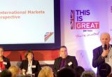 Presentation being given on understanding international markets with Patricia Yates at the lectern with the VisitBritain logo