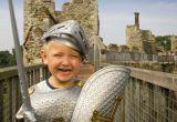 Little boy in roman costume at a castle