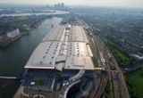Aerial view of East London over the Royal Docks, and the ExCel conference and events venue by the River Thames. Dusk.