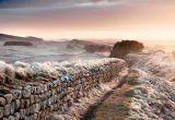 View along Hadrian's Wall on a frosty morning, England.