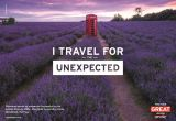 A red telephone box sits in the middle of a purple lavender field. The text 'I travel for the unexpected' features across the middle of the page and the GREAT campaign logo sits in the bottom right corner