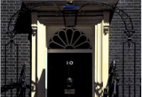 A photo of the black front door of No.10 Downing Street in Westminster