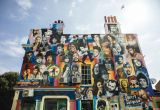Image of the facade of a pub in Brighton that has been graffiti'd all over with famous musicians and singers