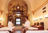 A Couple wearing white bathrobes relaxing in the Turkish Baths Spa in Harrogate, North Yorkshire, England.