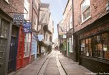 Image of a narrow historic street in York with gift shops