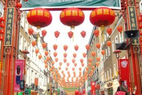 Crowd in Chinatown below rows of red lanterns