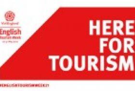 here for tourism logo