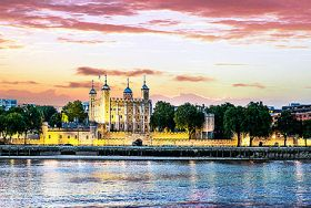 Silhouette of the Tower of London against a sunset