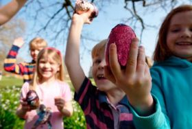 Children holding Easter eggs