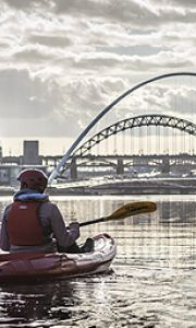 A couple of kayakers on the river in Newcastle
