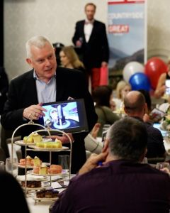 Man presenting to a table of people