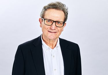 Peter Mills, man in white shirt and black suit with glasses