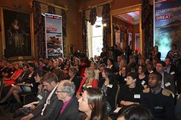 An audience of tourism professionals in a VisitBritain GREAT branded room