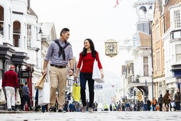 Young couple shopping in the high street in Guildford, Surrey