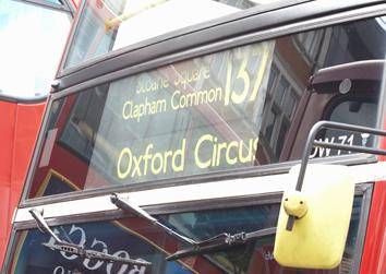 The front of a red London bus route 137 going via Sloane Square, Clapham Common to Oxford Circus