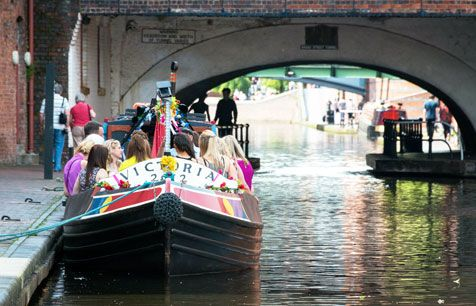 Young people on a boat in canal, Birmingham