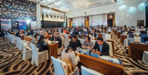 Delegates sitting at meeting tables discussing business at DestinationBritain China