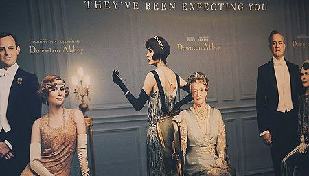 A poster of Downton Abbey characters on a wall at a campaign event in Sweden