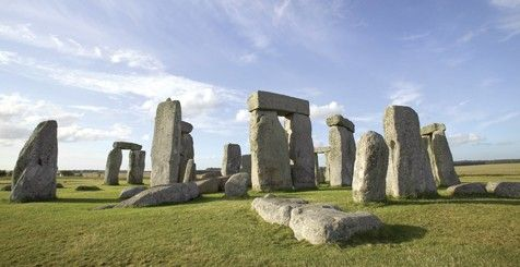 Stonehenge. Large slabs of rock leaning against each other in a field