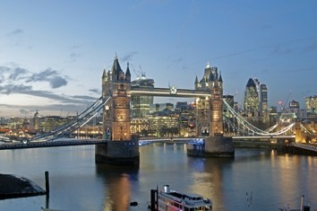 Tower Bridge in London illuminated in the early evening