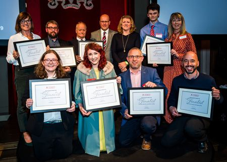 Group shot of Tourism Superstar finalists including winner Emily Hope holding certificates at the VisitEngland Awards 2019