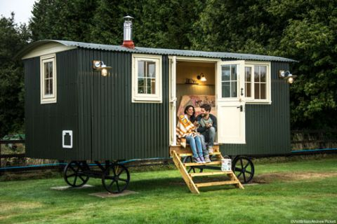 A couple in a caravan at Two Hoots glamping site, Hampshire