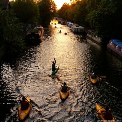 People kayaking at dusk on Regents canal