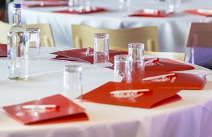 table with glasses and red leaflets