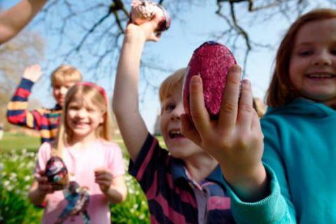 Children holding Easter eggs