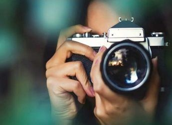 A camera pointing towards the user on a green background
