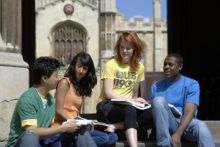 A group of four students sitting outside Warwick University
