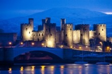 Conwy Castle in Wales illuminated at night