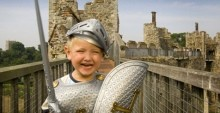 Little boy in roman costume at a castle